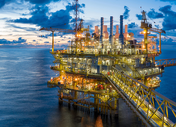 Panorama of Oil and Gas central processing platform in twilight.