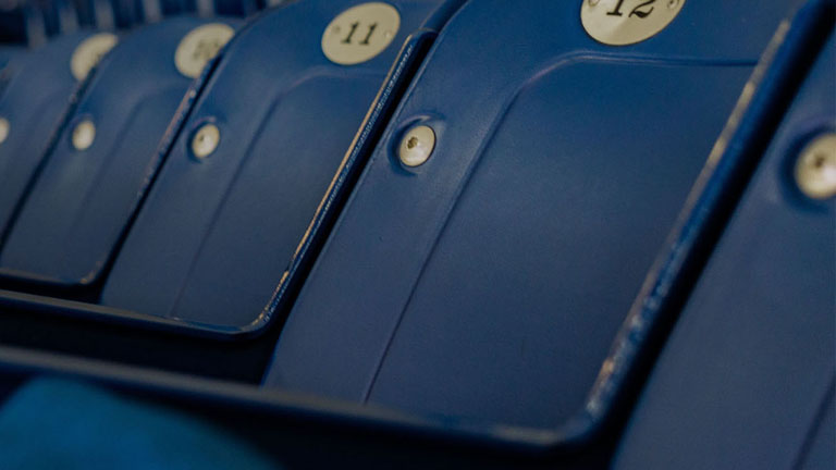 numbered blue seats in theatre